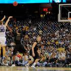 Duke's Jon Scheyer (No. 30) snapped out of a prolonged shooting slump just in time, scoring 18 points to help top-seeded Duke advance to the Elite Eight for the first time since 2004.