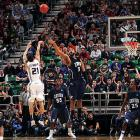 Denis Clemente scored 28 points, including two crucial three-pointers, for the second-seeded Wildcats, who will face fifth-seeded Butler Saturday in the regional final.
