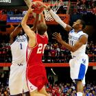 Kentucky's Darius Miller (No. 1) and John Wall (No. 11) put the clamps on Cornell's Ryan Wittman in the first half after the Big Red jumped out to a 10-2 lead. UK outscored Cornell 30-6 to take a 32-16 halftime advantage.