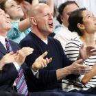 Federal law mandates that we provide at least one full color photograph each week of celebrities gawking or clapping at a basketball game. Here it is: the famed thespian, his wife Emma Heming, and Hornets owner George Shinn at New Orleans Arena on March 29.