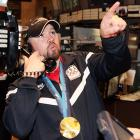 The Olympic gold medalist appears to be calling for help in removing his bobsled from the ceiling of the New York Stock Exchange.