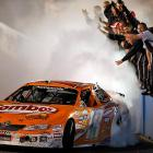 The stock car jockey gave his crew the finger (not <i>that</i> finger) and got back some spirited gesticulatin' after he won the Nationwide Series Bashas' Supermarkets 200 at Phoenix International Raceway in Arizona on April 9.