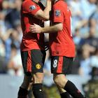 The Manchester United teammates seal their April 17 English Premier League victory with a kiss.