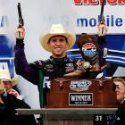 We hear that in yet another attendance-boosting initiative, NASCAR drivers have been ordered to settle their disputes with shootin' irons. Here, the winner of the Samsung Mobile 500 issues a warning to his foes at Texas Motor Speedway on April 19.