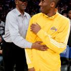 Just a lad and his dad hammin' it up before a big-time basketball game directed by Jack Nicholson at L.A.'s Staples Center on April 20.
