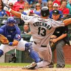 The Rangers' Matt Treanor tags out Seattle's Casey Kotchman during Texas' 9-2 home victory on April 11.