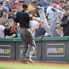 Dodgers first baseman James Loney falls into the stands while running after a foul ball hit by the Pirates' Andy LaRoche in the seventh inning of an April 5 game in Pittsburgh. Loney couldn't make the play, and the Pirates defeated the Dodgers 11-5.