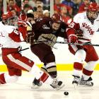Boston College's Barry Almeida gets squeezed between Wisconsin's John Ramage (right) and Podge Turnbull during the Frozen Four final on April 10. BC won 5-0 before a crowd of 37,592 at Ford Field in Detroit.