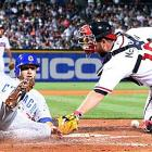 The Cubs' Mike Fontenot slides past Brian McCann to score on a sacrifice fly by Ryan Theriot. The Braves defeated Chicago 3-2 on April 7 in Atlanta.
