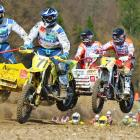 Emil Cook and Marius Strauss of Switzerland lead Maris Rupeiks and Kaspars Stupelis of Latvia during the ADAC German Moto Cross Championship on April 11.