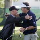 Mickelson hugs his father, Phil Sr., during a practice round at Winged Foot Golf Club in Mamaroneck, NY.