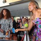 """Serena and Venus play table tennis at a """"Welcome to Melbourne"""" event hosted by the Olsen Hotel in Melbourne, Australia."""