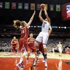 Maya Moore (No. 23) finished with 23 points as UConn rallied after falling behind 20-12 at halftime. She also grabbed a key offensive rebound off a missed free throw with 1:11 remaining.