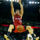 """Forced to miss the entire 2009-2010 season because of a stress fracture in his knee, Griffin has been excellent in his much-anticipated NBA debut. Along with averaging better than 20 points and 12 rebounds, Griffin has wowed even his peers with his explosive, high-flying dunks. Tweeted LeBron James: """"Man Blake Griffin is the most explosive player in the league! Crazy bounce."""""""
