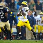 """One the most exciting players in college football, Robinson generated early-season Heisman hype for his breakout play in 2010.  The dynamic sophomore threw for 1,008 yards and ran for another 905 in Michigan's 5-0 start. Though the team has struggled since (it finished 7-5), """"Shoelace"""" propelled the Wolverines to the Gator Bowl against Mississippi State, their first bowl appearance in three years."""