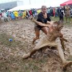 No, it's not Woodstock. It's the Kentucky Derby, where gleeful fans engaged in a little mudwrestling. The fellow here seems to have lost his shirt betting on the ponies.
