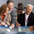"""Lisa France Kennedy, Brian France, Richard """"The Hat"""" Petty and Junior Johnson enjoyed a spirited round of pinochle while waiting for stock car racing's latest attraction to open in Charlotte on May 11. (Is Petty counting cards?)"""