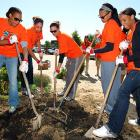 """Ever wonder where all those """"shovel-ready"""" jobs went? Now you know. These WNBA hoopsters were hard at work digging a victory garden at George Washington Middle School in Alexandria, Va., on May 10."""