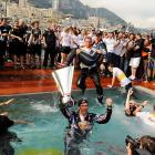 Do Formula One crews know how to celebrate or what? Mark Webber and his delirious band of merry men made quite a splash after winning the big race on May 16.