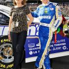 Mark Martin strikes the same pose as his wife Arlene at Daytona International Speedway.