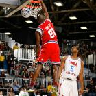 Showing off his hoops skills, T.O. dunked over Robert Horry during the NBA All-Star Celebrity Game.