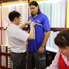The Houston Rocket swingman stopped by a big and tall men's store in Beijing on May 29 to get himself some new duds. Seems like an awful long way to go just to get a suit...