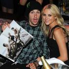 The motorcross rider displayed the kind of publication that makes the vicar blush while canoodling with his TV personality girlfriend at the Runway Magazine Summer 2010 Release Party in Hollywood.