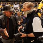 Happy to report that SI's veteran photographer is back on the beat after his unfortunate courtside accident, thanks to a state-of-the-art neck brace and a surgically attached third arm that automatically adjusts the contraption while Mr. McDonough works his cameras.