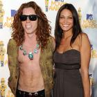 The Olympic hero seems to have lost his shirt as he arrives with a clearly amused guest at the MTV Movie Awards in Universal City on June 6.
