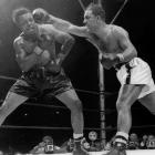 Marciano came off the canvas to score a ninth-round of knockout of Moore, the light heavyweight champion who had moved up in weight. It was the last fight of Marciano's career. He remains the lone heavyweight champion to retire undefeated.
