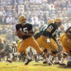 """The first-ever AFL vs. NFL """"World Championship Game"""" was played at the L.A. Coliseum in 1967 and pit the NFL's Green Bay Packers against the AFL's Kansas City Chiefs. Green Bay quarterback Bart Starr earned MVP honors by throwing two touchdown passes and leading the Pack to a 35-10 win. It is the only Super Bowl in history that failed to sell out. Why? Fans were unhappy about the cost of a ticket to the game: $12."""