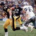 The rematch of Super Bowl X didn't disappoint as Terry Bradshaw threw four touchdown passes and Roger Staubach threw for three in the Steelers' 35-31 victory. Bradshaw was named MVP.