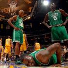 "The Celtics' title hopes were dimmed when Kendrick Perkins fell hard after colliding with Andrew Bynum midway through the first quarter. He sustained a sprained right knee and is questionable for Game 7. ""It doesn't look good"" said Boston coach Doc Rivers."
