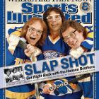 """Yeah, they're fictional characters. But the iconic Dave Hanson (Red Wings, North Stars) and Steve Carlson (Kings) did skate in the NHL as well as the beloved movie Slap Shot. Third """"brother"""" Jeff Carlson (right) was a minor league winger. Pass the foil."""