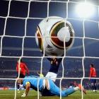 Chile's goalkeeper Claudio Bravo misses a shot from Spain's midfielder Andres Iniesta (not in frame), giving Spain a 2-0 lead.