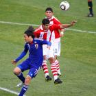 Carlos Bonet (middle) heads the ball away on an attempt for Japan midfielder Yasuhito Endo. The two tussled all day, with Endo committing four fouls in the match.