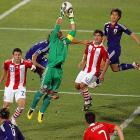 Paraguay goalkeeper Justo Villar only had two saves in the match, but he was in the middle of the action constantly, as evidence by this leaping grab at a cross attempt.
