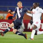 Midfielder Jay DeMerit (left) outruns England's Emile Heskey to the ball.