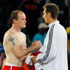 England's Wayne Rooney and Germany's Miroslav Klose swap jerseys after the match. Rooney had no goals in the World Cup, while Klose has two.