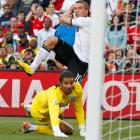 England goalkeeper David James watches as Lukas Podolski's first-half strike goes into the net. Podolski has scored twice in the 2010 World Cup.