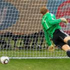 German keeper Manuel Neuer tries in vain to reach Frank Lampard's controversial first-half strike that was not ruled a goal. The shot hit the crossbar and, upon replay, was an obvious goal.