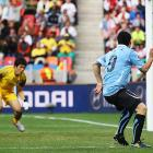 Luis Suarez scores the first of his two goals against South Korea in the first round of 16 match. Uruguay advanced to face Ghana in the quarterfinals.