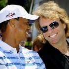 "Seen during the opening ceremony of the AT&T National in Newtown Square, PA. Makes one wonder if Bon Jovi gigglingly told Tiger, ""You give love a bad name."""