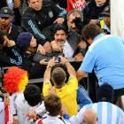Argentina's spirited coach had some choice words for the fans celebrating behind his bench after his team got its tail kicked by Germany in a World Cup quarterfinal match on July 3.