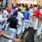 A bull honks his horns in an effort to make revelers yield the right of way at the annual running in Pamplona.