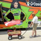 We suspect that the tyke in the wagon wants daddy to go to ChicagoLand Speedway's ice cream stand instead...