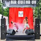 """From the looks of it, these two contestants are cranking their way through a spirited version of Spinal Tap's classic """"Tonight I'm Gonna Rock You Tonight"""" in London's Victoria Park."""