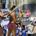 More ample evidence that the margin between victory and defeat often lies in a properly designed swimsuit: the bubbly beach volleyball duo celebrate their triumph in the women's final of the AVP Long Beach Open on July 25.