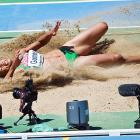 Naide Gomes didn't let the long jump competition spoil her day at the beach in Barcelona, Spain. She brilliantly combined the two.