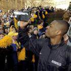 Wade videotapes the crowd as he gets on the bus at a farewell rally before the 2003 Final Four.